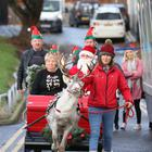 The team of local National Lottery winners arrived at the Royal Belfast Hospital for Sick Children with Santa and his reindeer.