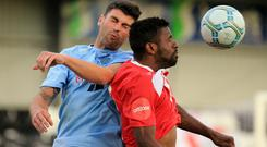 Former Ballymena defender Johnny Flynn (left) has retired, aged just 29.