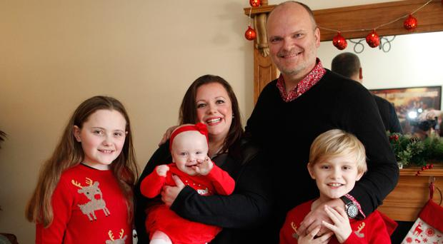 Festive fun: Kerry, husband Ralph and children get ready for Christmas