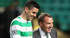 Awkward situation: Celtic's Tom Rogic, here with boss Brendan Rodgers, has been called up for Australia, forcing him to potentially miss the Bhoys' clash with Rangers on December 29