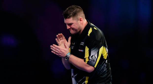 Daryl Gurney looks dejected during his match against Jamie Lewis during day ten of the William Hill World Darts Championships at Alexandra Palace, London. John Walton/PA Wire
