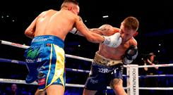 Josh Warrington (left) and Carl Frampton in action.