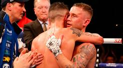 Josh Warrington (right) and Carl Frampton embrace after the World Featherweight Championship at Manchester Arena. Martin Rickett/PA Wire