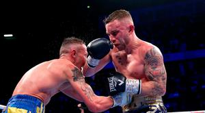 Hard fought: Carl Frampton (right) and Josh Warrington exchange blows in Manchester on Saturday night