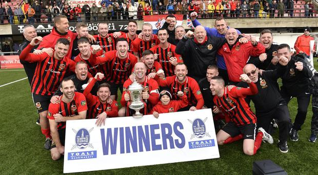 East Belfast players celebrate after winning the cup. Photo by Stephen Hamilton.