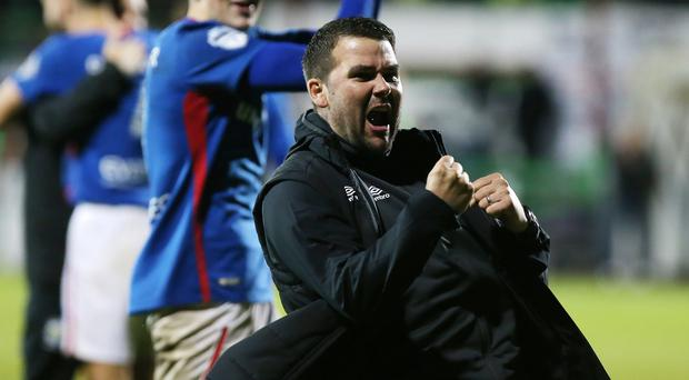 Special feeling: Linfield manager David Healy roars with delight after beating Glentoran at The Oval in October