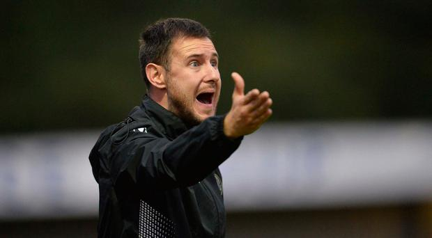 Shouting odds: Warrenpoint Town manager Stephen McDonnell insists his boys will play the game and not the occasion