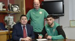 Sign here: Joe Gormley signs his new Reds deal as chairman Gerard Lawlor and manager Barry Gray look on
