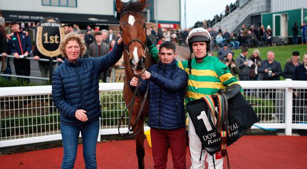 Centre of attention: Stand Up And Fight and jockey Derek O'Connor in the winners' circle at Down Royal