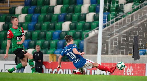 Net gains: Jordan Stewart fires home for Linfield