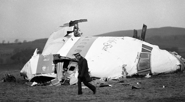 Horrific aftermath: the plane's nose section lies in a field in Lockerbie