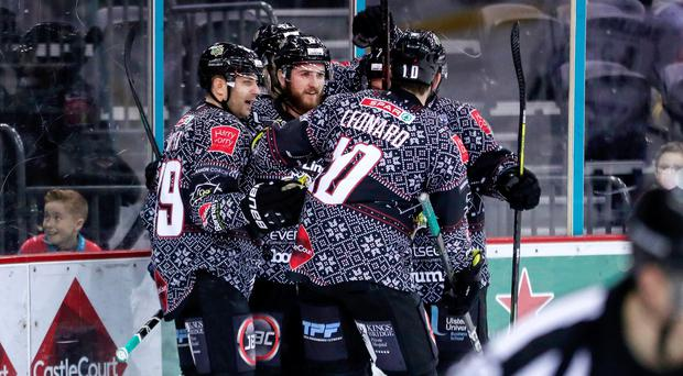Goals galore: Belfast Giants' Lewis Hook celebrates with team-mates after scoring in their convincing win over Milton Keynes Lightning