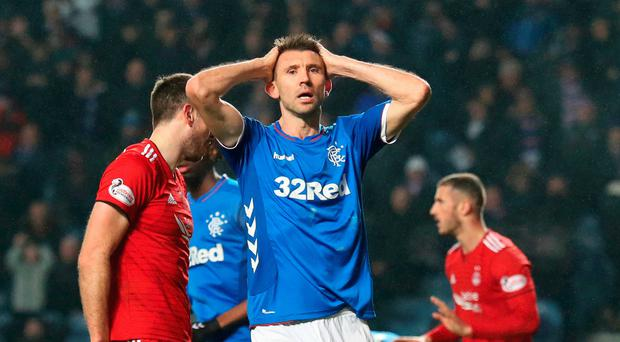 Fitness battle: Rangers ace Gareth McAuley is racing against time in his bid to be available for the Old Firm clash at Ibrox