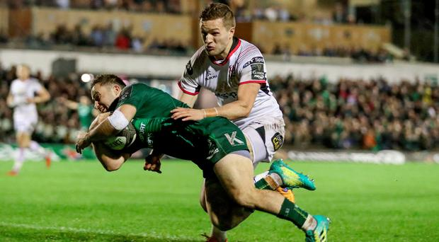 In vain: Ulster's Johnny McPhillips is unable to prevent Connacht's Caolin Blade from scoring a try