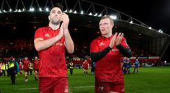 Job done: Munster's Conor Murray and Keith Earls celebrate a big win over Leinster