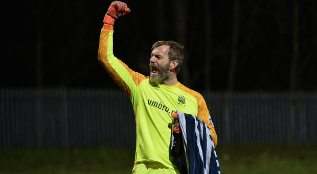 Linfield's Roy Carroll celebrates his side's festive victory over Cliftonville. Photo Colm Lenaghan/Pacemaker Press