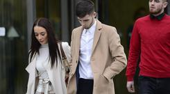 Jay Donnelly (brown/camel coat) pictured with family and friends leaving court today. Picture By: Arthur Allison/Pacemaker Press