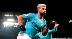 First blood: Sergio Aguero celebrates after opening the scoring in Manchester City's 2-1 victory over Liverpool at the Etihad