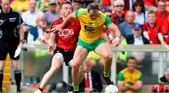 Bit of previous: Down's Brendan McArdle keeps close tabs on Michael Murphy of Donegal