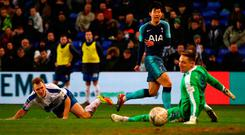 On its way: Son Heung-min scores Tottenham's fourth goal past Scott Davies of Tranmere Rovers