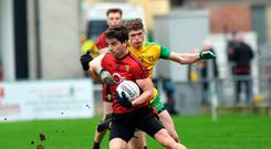 Hands on: Down's Conor Poland holds off Donegal rival Conor Morrison