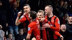 Cup kings: Paul Heatley (pictured) and Jordan Owens shoot down Glentoran at Seaview as Crusaders progress to the sixth round of the Tennent's Irish Cup