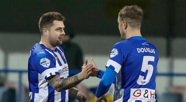 Net gains: James McLaughlin is congratulated by Coleraine team-mate Steven Douglas after finding the target in the Irish Cup
