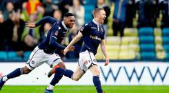 Double delight: Shane Ferguson celebrates after becoming Millwall's hero