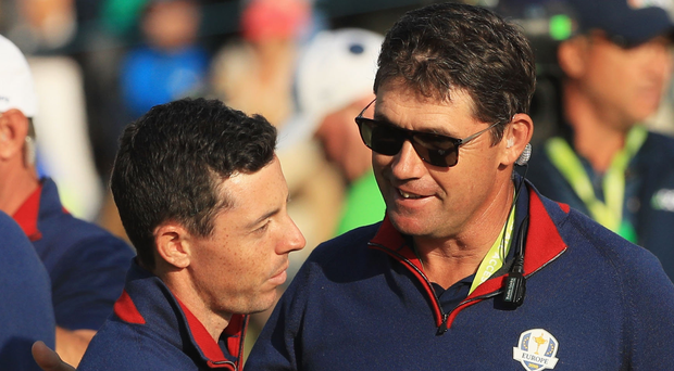 Victors: Rory McIlroy (left) and Padraig Harrington celebrate Europe's win at Le Golf National