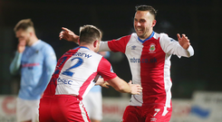 Full circle: Andrew Waterworth celebrates with Jamie Mulgrew after scoring against Ballymena United