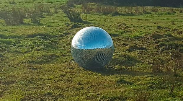 Last dance: the disco ball that was found high on a mountain road outside Belfast