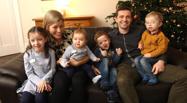 Former Cliftonville player Chris Scannell relaxing at home in Dunmurray with wife Ciara, and children, Erin, Odhran, Aidan and Meabh. Pic by Peter Morrison