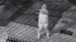 CCTV of a gun man involved in a gun attack on the Sinn Fein constituency office at Monaghan Crescent in Turf Lodge. Picture credit: Pacemaker