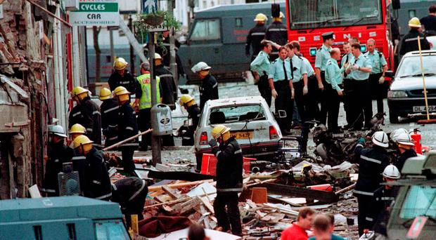 Shocking atrocity: police and firemen at the scene of the Omagh bomb