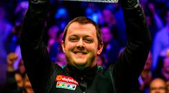 Big moment: Mark Allen celebrates his Masters triumph