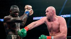 Play it again: Tyson Fury (right) and Deontay Wilder
