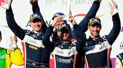 Winning feeling: Wayne Boyd shares the podium with United Autosports team-mates Garett Grist and Chris Buncombe