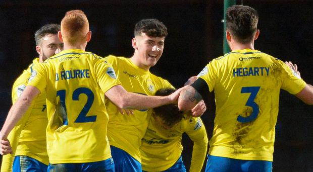 Young gun : Oisin Smyth (centre) celebrates a precious point for Dungannon