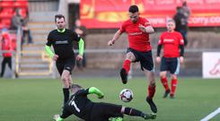 Glenn Irwin is tackled by Gary Dunlop during the charity game at Seaview