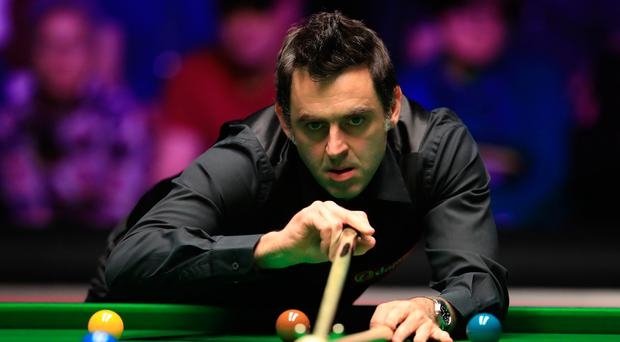 Taking aim: Ronnie O'Sullivan during his opening victory