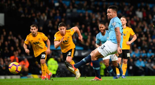 Cool head: Gabriel Jesus slots home a penalty for his and City's second goal