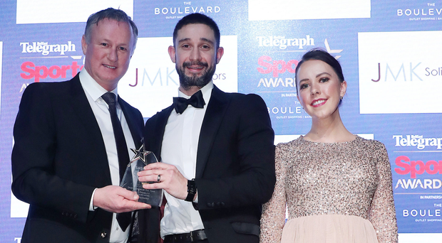 Golden boy: Philip Robinson (coach) receives the Sportsperson with a Disability on behalf of James MacSorley from Michael O'Neill and Una O'Neill from JMK Solicitors