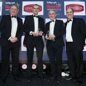 Gold standard: Tyrone chief Mickey Harte last night received the Gold Award in the Coach of the Year category from Linwoods' Stephen Allen