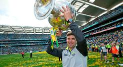 Hollow victory: Kerry boss Eamonn Fitzmaurice holds the Sam Maguire Cup aloft back in 2014