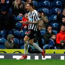 Close call: Joselu celebrates scoring for Newcastle