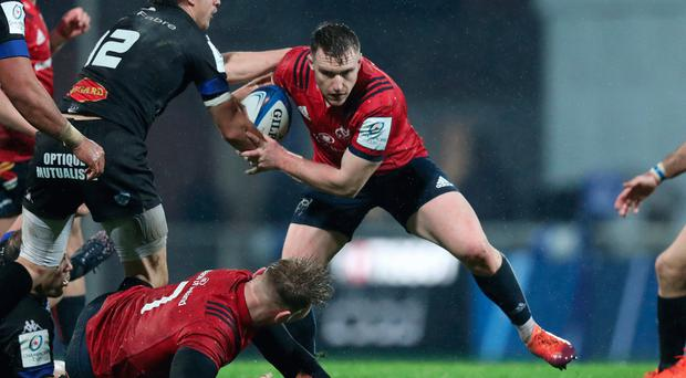 On the ball: Rory Scannell is delighted with Munster's form as the Champions Cup groups reach a climax