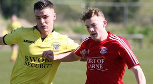 Larne's Liam Hassin (right) is attracting interest from England and Scotland
