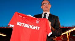 Nottingham Forest manager Martin O'Neill poses with a shirt after a press conference at the City Ground, Nottingham. Pic Pa