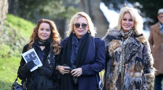 From left Julia Sawalha, Joanna Lumley and Jennifer Saunders leave All Hallows Church in Tillington, West Sussex (Andrew Matthews/PA)