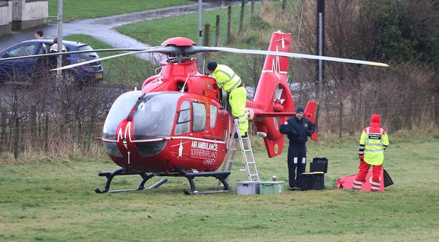 Engineers work on the Northern Ireland Air ambulance at the scene of a call out to Articlave Co Londonderry, the Air Ambulance was off line for a period while repairs were carried out. Pic Steven McAuley/McAuley Multimedia